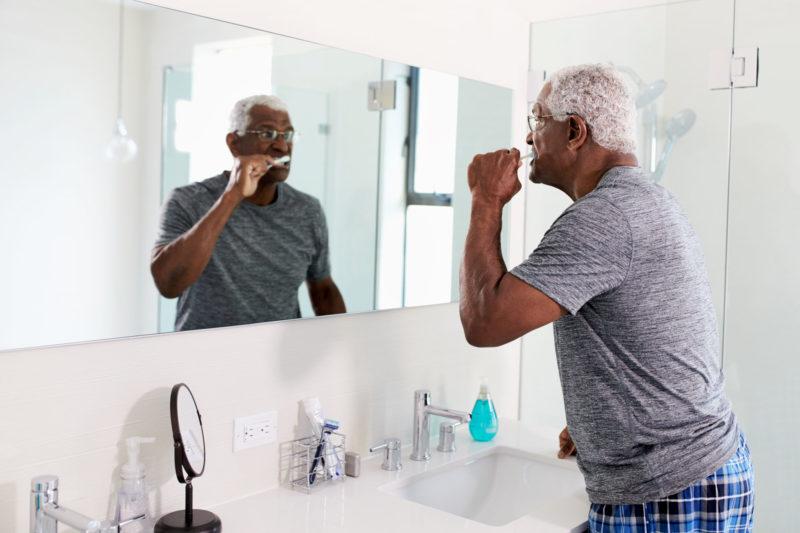 senior man brushing teeth 800x533 - Brush Your Teeth -- Prevent Alzheimer's